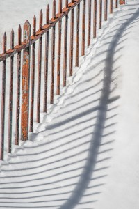 Fence Shadows on Snow by: Rick Sereque